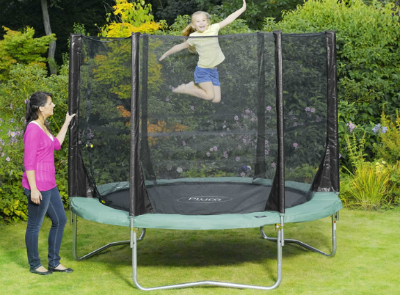 girl on trampoline while her mum watches