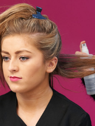 Spray sections of hair with heat defence spray