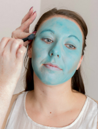 Paint face with green face paint