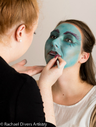 Line the lips with black face paint or eyeliner