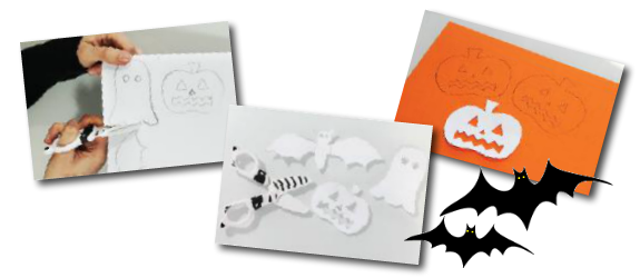 cut out spooky shapes from card