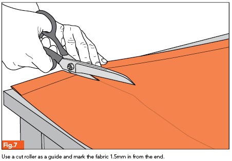 Fig. 7 - Use a cut roller as a guide and mark the fabric 1.5mm in from the end