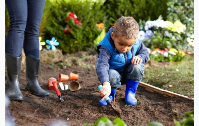 Child digging in garden