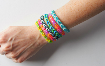 Loom band bracelets on wrist