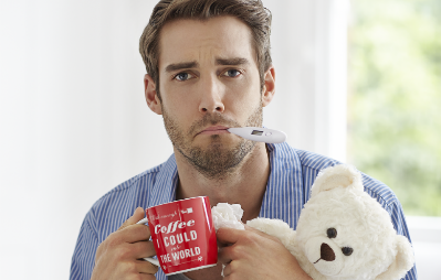 sick man with thermometer and teddy bear