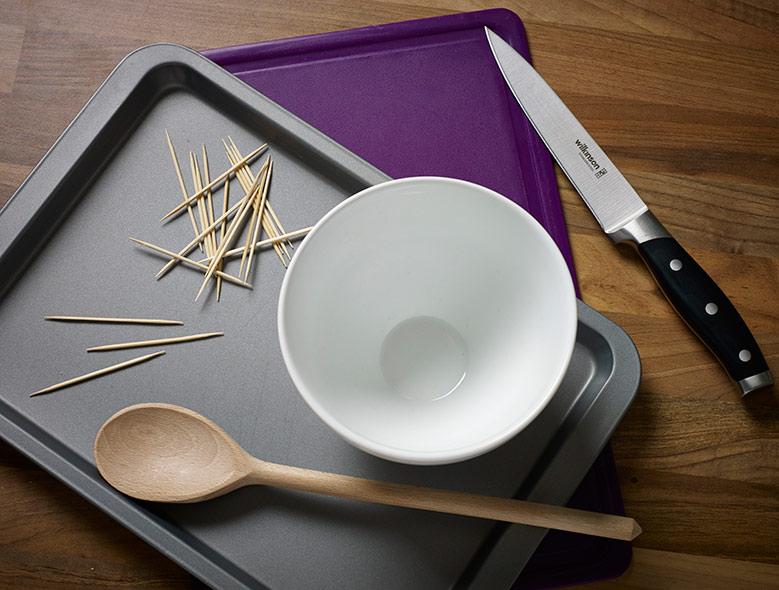 toothpicks, baking tray, wooden spoon, sharp knife, bowl
