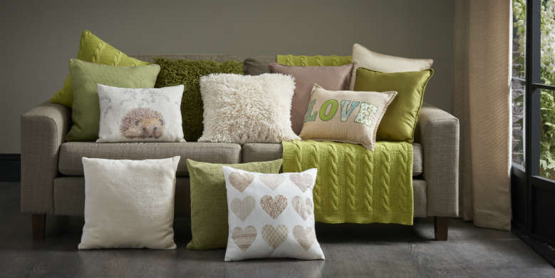 nest sofa with cushions and throw