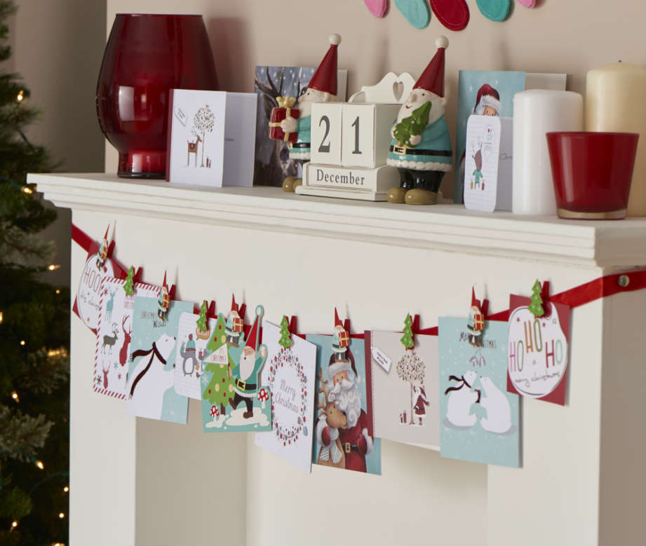 Christmas cards hung on fireplace