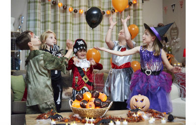 kids at halloween party in costumes